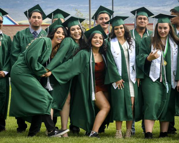 Members of the class of 2019 at Bridges High School have a little fun as they pose for a class photo Friday at The Orchard.