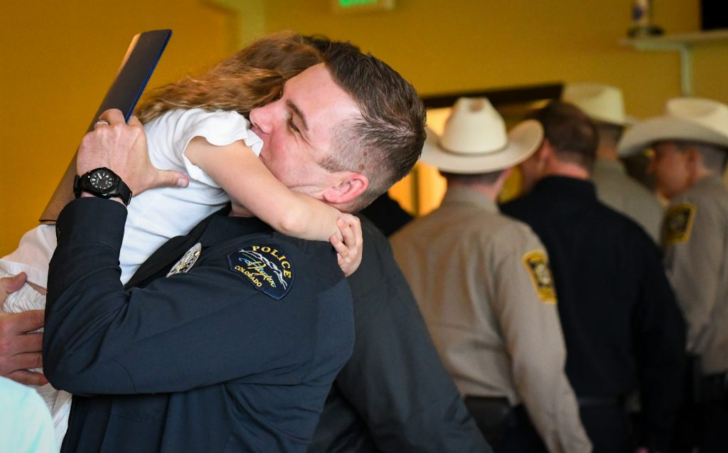 Colorado Mountain College CLETA graduate and new Hayden Police Officer Tague Humenik is greeted by is family after the graduation ceremony at the Spring Valley Campus on Thursday afternoon.