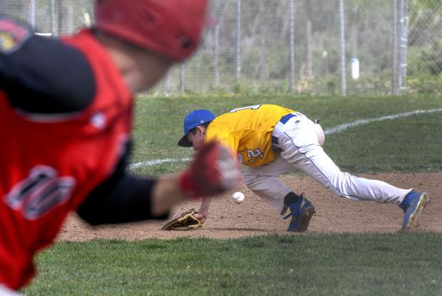 Grand Valley's Brandon Millius hustles to first as he watches Roaring Fork's Mason Smith mishandle a line drive at third base in the fourth inning Thursday in Parachute.