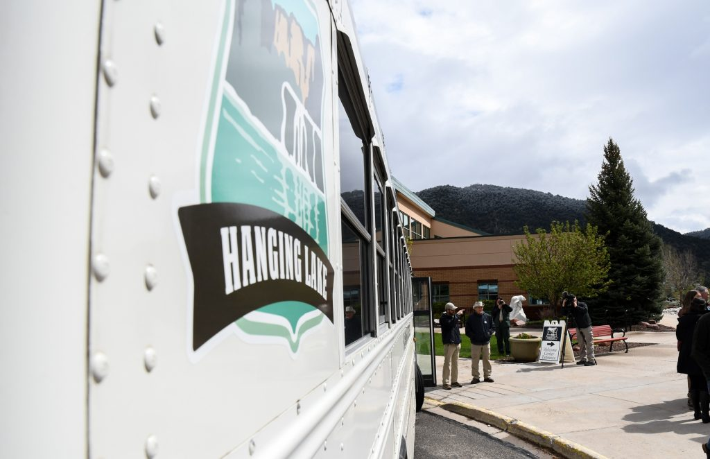 People board the Hanging Lake Express shuttle service at the new welcome center after the ribbon cutting ceremony on Wednesday morning.