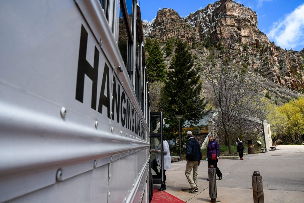 People board the Hanging Lake Express shuttle service at the trailhead to return to the welcome center on Wednesday morning.