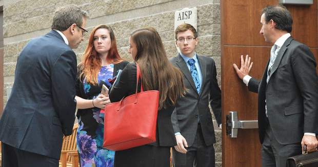 Allison Marcus, second from left, and Richard Miller, second from right, with their attorneys at a court proceeding earlier this year. A possible plea disposition will be unveiled in court Wednesday.