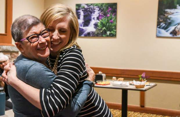Kati Ledall hugs Threads of Love volunteer Joan Isenberg during their weekly get together at Valley View Hospital.