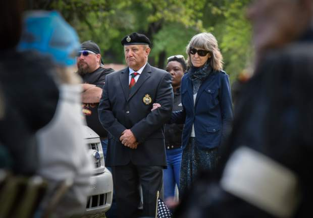 Members of the audience stand together during the 2019 Memorial Day ceremony held at Rosebud Cemetery in Glenwood on Monday.