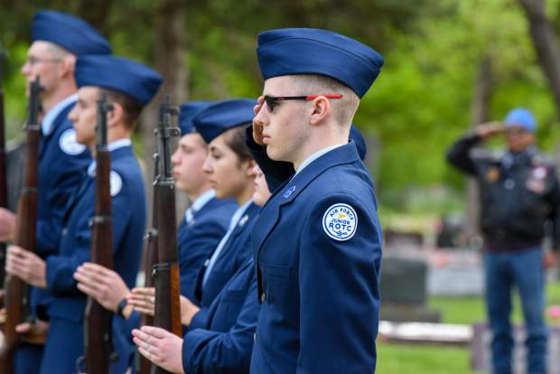 Members of the Glenwood Springs High School Air Force JROTC stand together following the Salute of the Dead near the closing of the 2019 Memorial Day ceremony held at Rosebud Cemetery in Glenwood Springs on Monday.