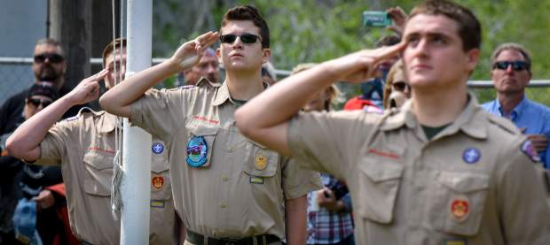 Members of Boy Scout Troop 225 salute the flag during the lowering of the colors during the the 2019 Memorial Day ceremony held at Rosebud Cemetery in Glenwood Springs on Monday.