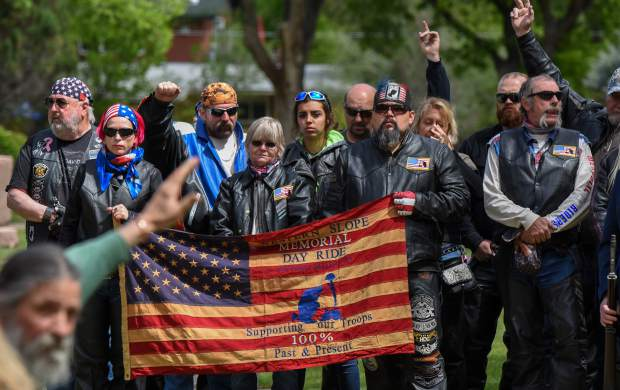 Veteran members of the audience are asked to raise their hands to be recognized during the opening of the 2019 Memorial Day ceremony held at Rosebud Cemetery in Glenwood Springs on Monday.