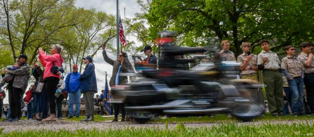 People watch as the Western Slope Memorial Riders leave Rosebud Cemetery during the closing of the 2019 Memorial Day ceremony on Monday morning.