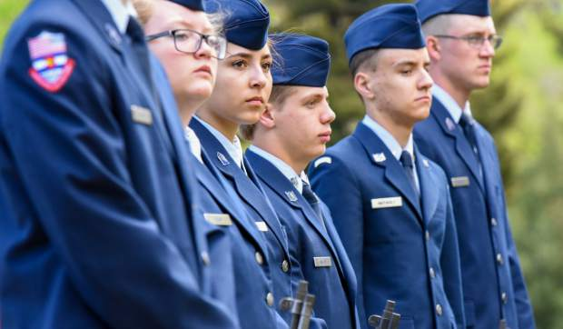 Members of the Glenwood Springs High School Air Force JROTC stand together during the 2019 Memorial Day ceremony held at Rosebud Cemetery in Glenwood Springs on Monday.