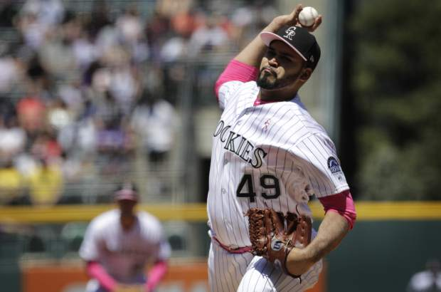 Colorado Rockies starting pitcher Antonio Senzatela throws against the San Diego Padres in the first inning of a baseball game in Denver, Sunday, May 12, 2019. (AP Photo/Joe Mahoney)