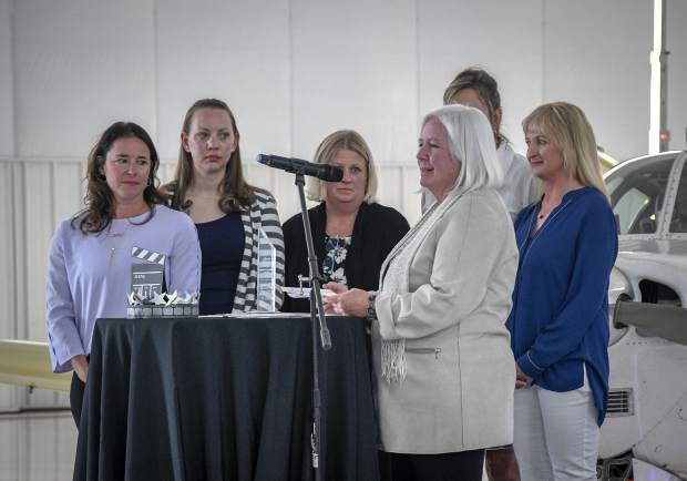 Chairwoman Helen Rogers and other members of the New Ute Theater Society accept the award for the top nonprofit organization of the year last Saturday at the Chamber of Commerce annual dinner and awards ceremony.