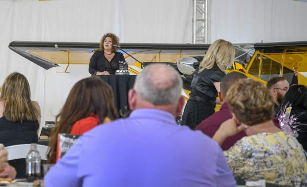 New Your Chamber serving the Colorado River Valley director Tanya Doose talks during the annual dinner and awards Saturday at Garfield County Airport.