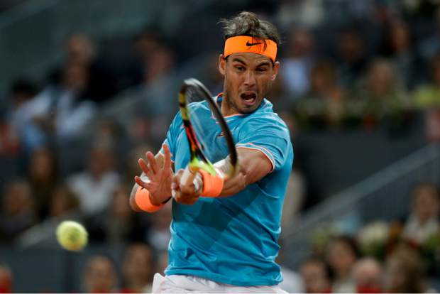 Rafael Nadal of Spain returns the ball to Stefanos Tsitsipas of Greece during the Madrid Open tennis men's semi-final match in Madrid, Spain, Saturday, May 11, 2019. (AP Photo/Bernat Armangue)