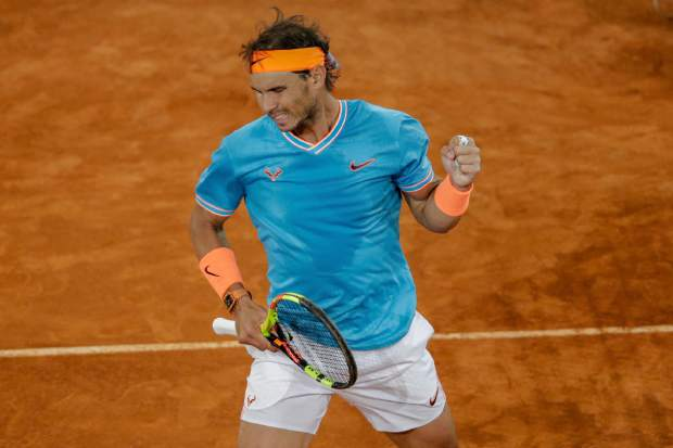 Rafael Nadal of Spain celebrates a point during the Madrid Open tennis men's semi-final match against Stefanos Tsitsipas of Greece in Madrid, Spain, Saturday, May 11, 2019. (AP Photo/Bernat Armangue)