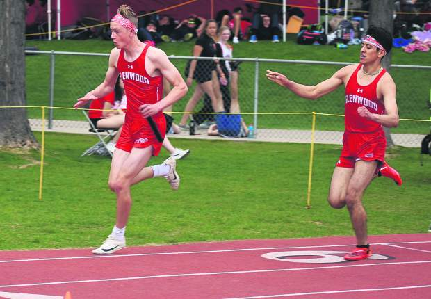 Glenwood Springs junior Patrick Young takes the handoff from a Demon teammate during the 4x200m relay Thursday at the 4A state track and field championships.