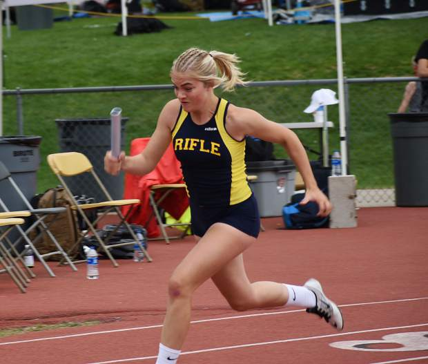 Rifle's Halie Holmes fires out of the starting block in the 3A 800m sprint medley relay Thursday afternoon.