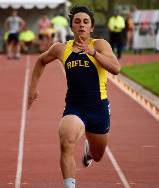Rifle senior Tanner Vines sprints to the finish line in the 100m dash Thursday at JeffCo Stadium.