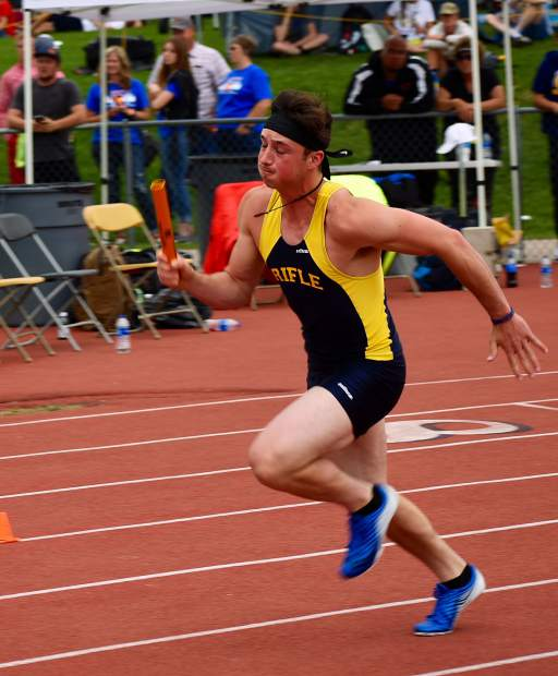 Rifle's Dalton Pruett races out of the starting block in the first leg of 3A 4x200m relay Thursday.