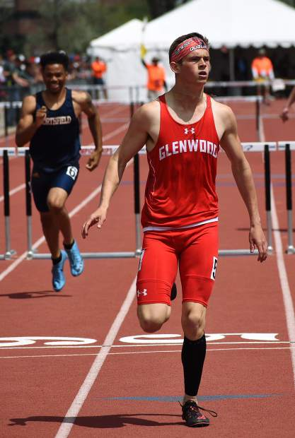 Glenwood senior Wyatt Ewer looks up at the scoreboard to see his final time in a 110m hurdle heat race Friday morning at JeffCo Stadium. Ewer won the heat and advanced to the 4A 110m hurdle final Saturday.