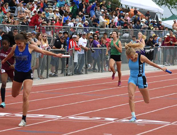 Coal Ridge freshman Peyton Garrison leans into the finish line Friday at the end of the 4x200m relay, giving Coal Ridge a second-place finish.