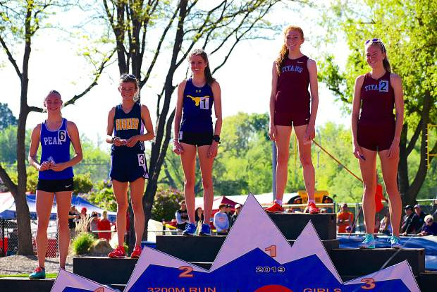Basalt sophomore Sierra Bower stands on the podium in second after the conclusion of the 3A 3200m run.