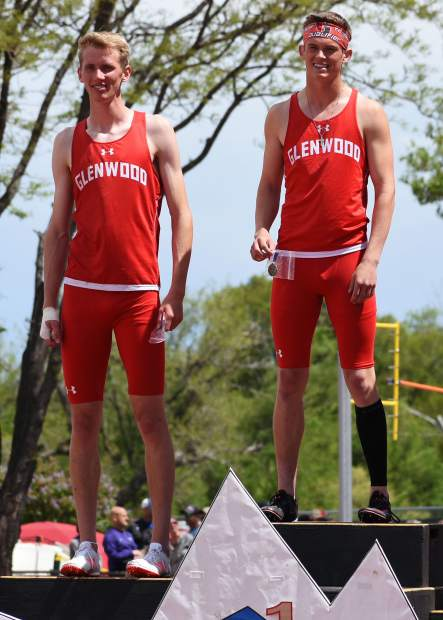 Glenwood Springs senior Wyatt Ewer holds his championship medal for the 4A 300m hurdles, while teammate Bryce Risner stands next to him in second place.