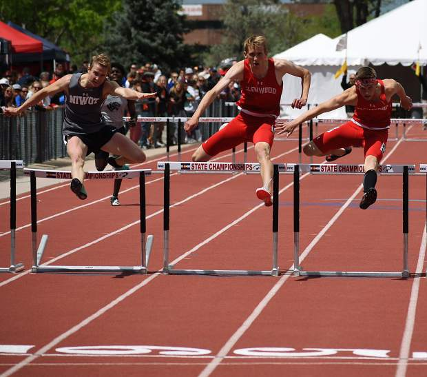 Seniors Bryce Risner (center) and Wyatt Ewer (right) leap over the final hurdle Saturday in the 4A 300m hurdles, while Niwot's Jensen Doulliard, left, closes in. Ewer edged Risner by 4/100ths of a second to win the 4A state championship.