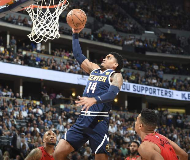 Denver Nuggets guard Gary Harris, center, goes up for a basket between Portland Trail Blazers guards Damian Lillard, back, and CJ McCollum in the first half of Game 7 of an NBA basketball second-round playoff series Sunday, May 12, 2019, in Denver. (AP Photo/John Leyba)