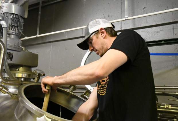 Brewer Eric Metzger mixes grain for the IPA that will be served in the new downtown Glenwood location.