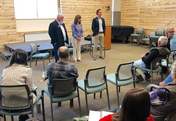 Colorado state representatives Perry Will, left, Julie McCluskie and Dylan Roberts field questions from an audience in Basalt last week.