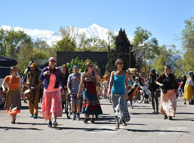 Ngoma Drum and Dance lead the parade of species to celebrate Dandelion Day in Carbondale.