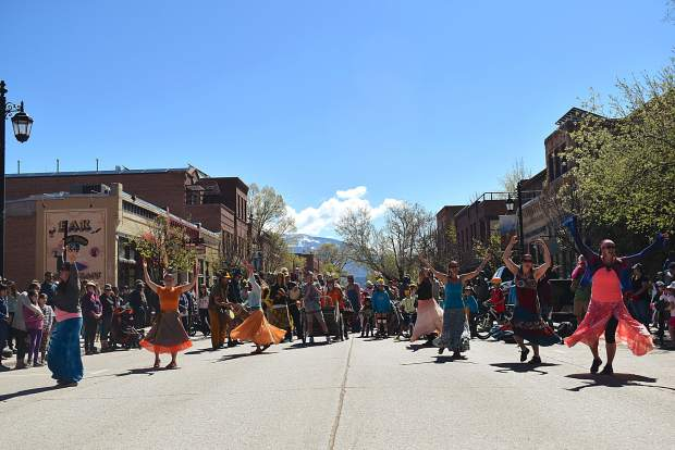 Ngoma Drum and Dance lead a parade of species to celebrate Dandelion Day in Carbondale.