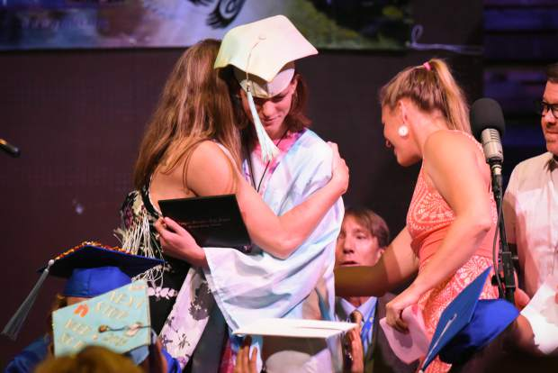 A Yampah Mountain High School graduate receives his diploma during the commencement ceremony held in Carbondale on Friday morning.