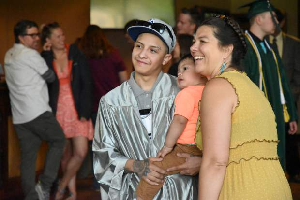 A Yampah Mountain High School graduate poses for a photo with family before the ceremony in Carbondale on Friday morning.