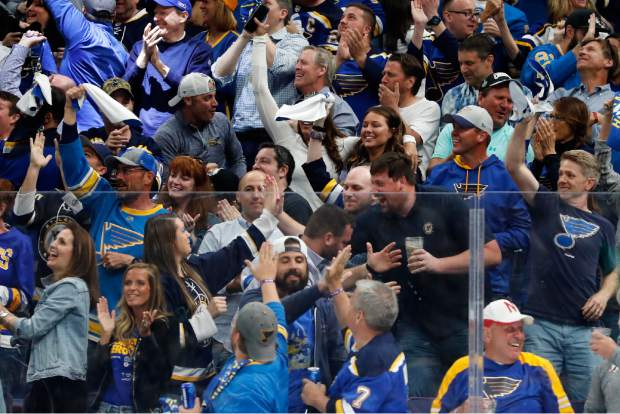 St. Louis Blues fans celebrate after a goal during the third period of Game 4 of the NHL hockey Stanley Cup Final against the Boston Bruins Monday, June 3, 2019, in St. Louis. The Blues won 4-2 to even the series 2-2. (AP Photo/Jeff Roberson)