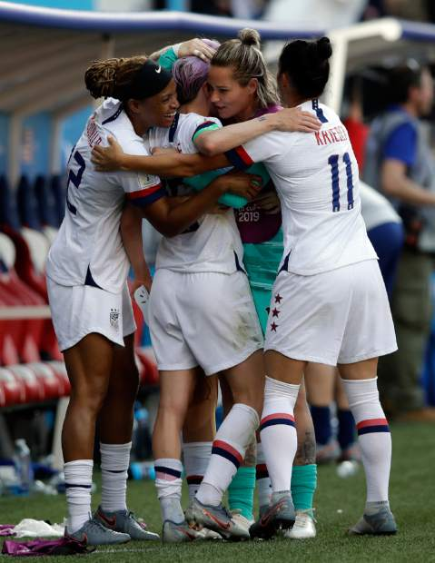 United States players celebrates at the end of the Women's World Cup round of 16 soccer match between Spain and US at the Stade Auguste-Delaune in Reims, France, Monday, June 24, 2019. US beat Spain 2-1. (AP Photo/Alessandra Tarantino)