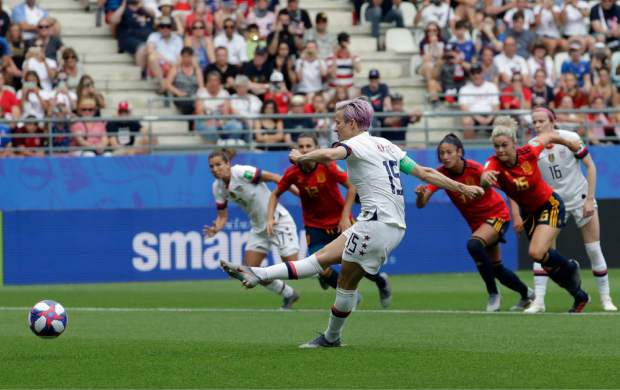 The United States' Megan Rapinoe scores the opening goal from a penalty spot during the Women's World Cup round of 16 soccer match against Spain at the Stade Auguste-Delaune in Reims, France, on Monday. (AP Photo/Alessandra Tarantino)