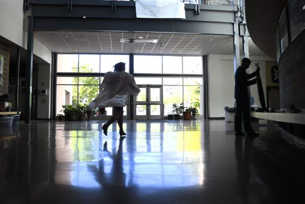 A soon-to-be graduate run sthrough the halls of Glenwood High School one last time as the ceremony nears.