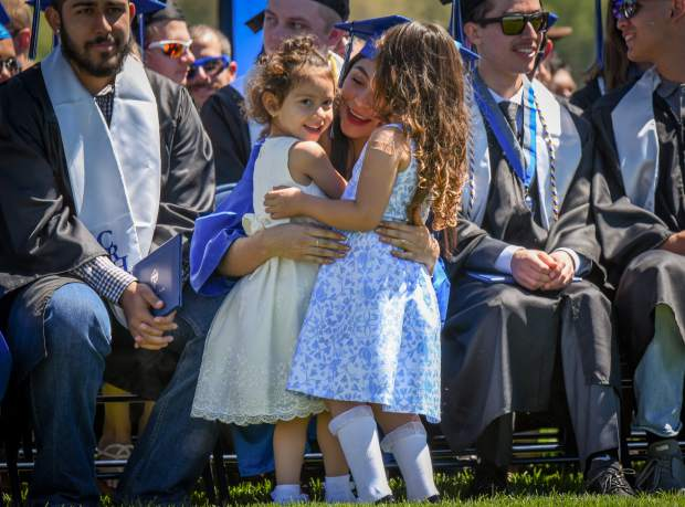A 2019 Coal Ridge HIgh School graduate is embraced by family members during the ceremony held at the school on Saturday morning.