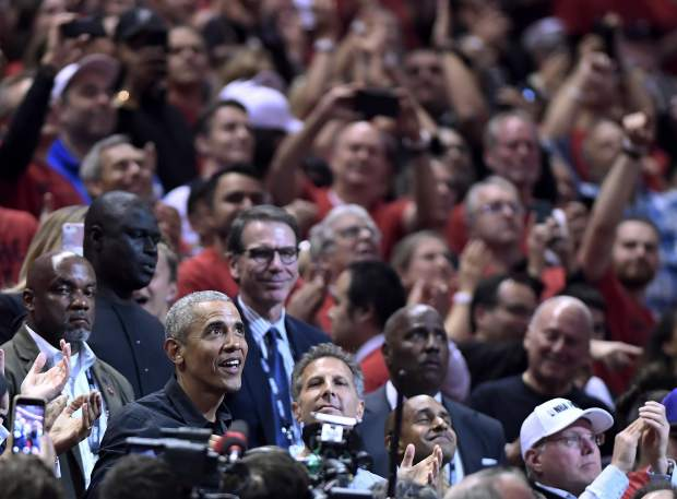 Former President Barack Obama looks up during the first half of Game 2 of basketball's NBA Finals between the Golden State Warriors and the Toronto Raptors, Sunday, June 2, 2019, in Toronto. (Frank Gunn/The Canadian Press via AP)