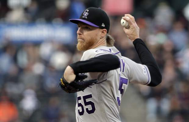 Colorado Rockies pitcher Jon Gray throws to a San Francisco Giants batter during the first inning of a baseball game in San Francisco, Monday, June 24, 2019. (AP Photo/Jeff Chiu)