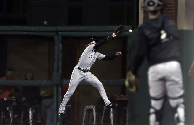 Colorado Rockies right fielder Charlie Blackmon cannot catch a triple hit by San Francisco Giants' Kevin Pillar during the sixth inning of a baseball game in San Francisco, Monday, June 24, 2019. (AP Photo/Jeff Chiu)