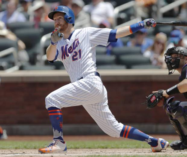 New York Mets Todd Frazier watches his three-run, home run during the first inning of a baseball game, Sunday, June 9, 2019, in New York. (AP Photo/Kathy Willens)