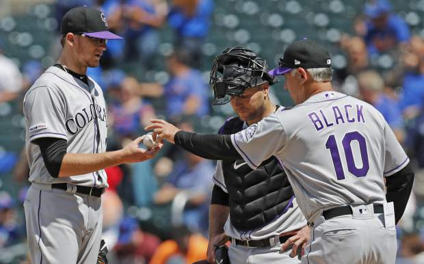 Colorado Rockies manager Bud Black (10) takes the ball from Rockies starting pitcher Jeff Hoffman (34) during the sixth inning of a baseball game against the New York Mets, Sunday, June 9, 2019, in New York. Catcher Chris Iannetta is at center. (AP Photo/Kathy Willens)
