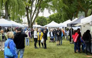 Vendors, festival goers weather soggy Strawberry Days