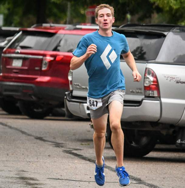 Glenwood's Gavin Harden dashes to the finish line at the end of the 10K Strawberry Shortcut race on a cold and wet Sunday morning.