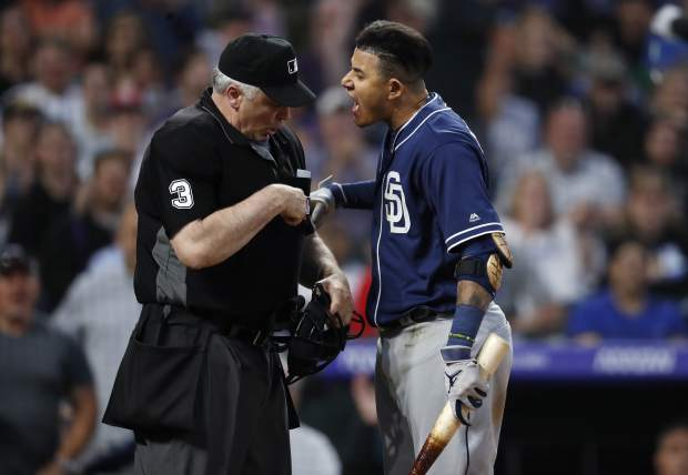 San Diego Padres' Manny Machado, right, yells at home plate umpire Bill Welke, who had called Machado out on strikes during the fifth inning of the team's baseball game against the Colorado Rockies on Saturday, June 15, 2019, in Denver. (AP Photo/David Zalubowski)
