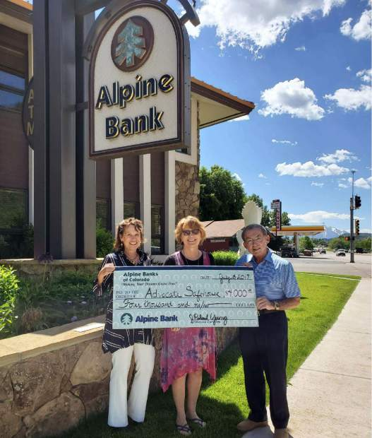 From left: Debbie Lundin, Alpine Bank, assistant to the chairman; Julie Olson, Advocate Safehouse Project executive director; and Bob Young, Alpine Bank, chairman.
