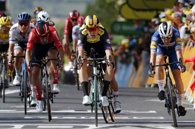 Belgium's Wout Van Aert celebrates Monday as he crosses the finish line in Albi to win the tenth stage of the Tour de France.