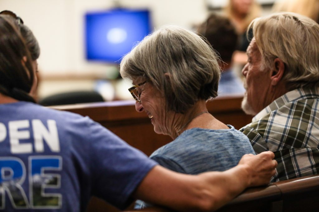 Andee McCauley cries beside her husband, Bill, during the Lake Christine Fire sentencing hearing Monday in Eagle County. The McCauley's lost their house to the July 2018 wildfire.